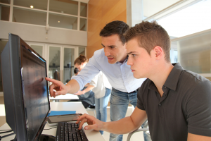 teacher-and-student-working-on-computer-1